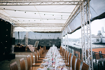 Beautiful wedding table decoration. Catering service on the roof