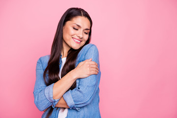 Portrait of her she nice cute sweet winsome lovely attractive charming cheerful cheery lady hugging herself life good mood closed eyes isolated over pink pastel background