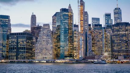 Beautiful Manhattan skyline and New York city lights in the evening