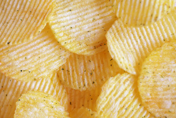 Golden wavy chips close-up