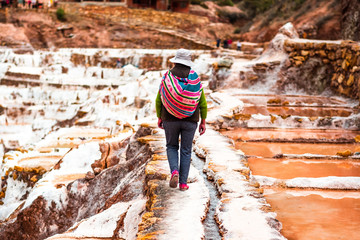 Worker at Salinas de Maras near Cusco, salt extraction in Peru