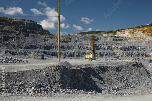 Quarry drilling machine in the limestone quarry in a sunny