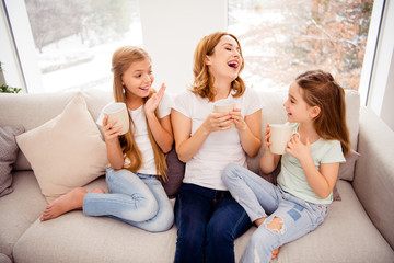 High angle view portrait of nice cute lovely attractive charming cheerful cheery positive ginger hair people mom mommy mum pre-teen girls sitting on divan in house indoors