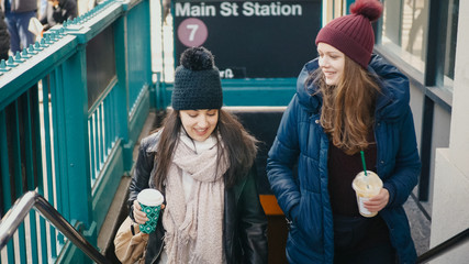 Two young women at a New York subway station