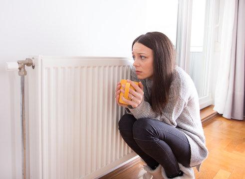 Girl beside radiator