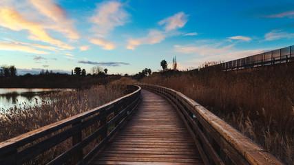 Wooden bridge on the lake at sunrise