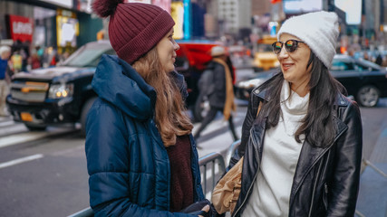 Two friends enjoy their vacation trip to New York