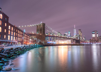 View on Financial district at night from Dumbo with long exposure
