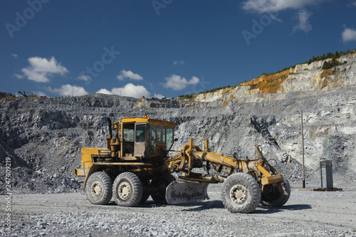 Grader in a quarry for limestone mining  Mining industry