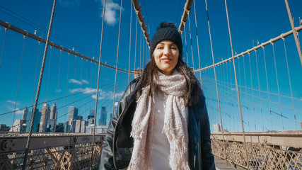 Happy girl in New York enjoy the beautiful Brooklyn Bridge