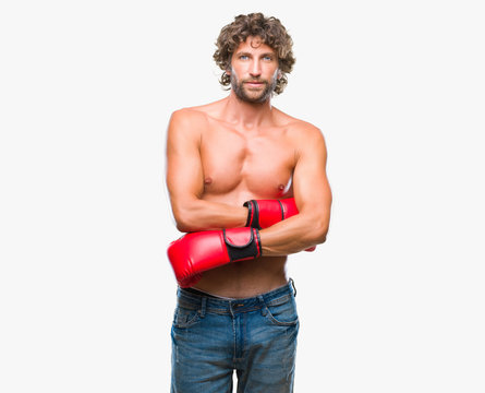 Handsome hispanic boxer man wearing boxing gloves over isolated background {.tf1\ansi\ansicpg1252\cocoartf1404\cocoasubrtf470