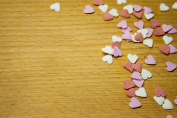 Powder cake from the heart on a wooden background. Background..