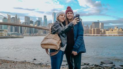 Two young women in New York enjoy the breathtaking Manhattan Skyline