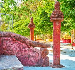 The crocodile handrail in Mahazedi Paya, Bago, Myanmar