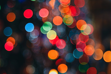 Bokeh. Defocused multi colored lights, christmas background abstract texture