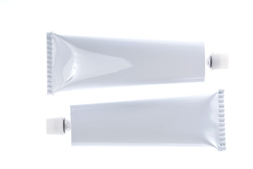 Close up of aluminum tube isolated on white background. Cosmetic or medicine gel.