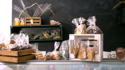 Organic bakery products on table. Modern bakery with assorted baked goods on counter. Healthy pastry shop.
