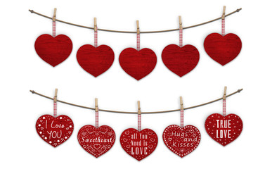 cute red wooden hearts hanging on clothes pegs, blank and decorated with text  I love you, isolated on white background