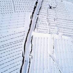 Valtellina (IT) - Vigneto a gradoni con neve fresca