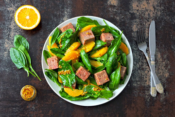 Healthy salad with spinach, orange and smoked salmon. Keto diet. Healthy eating concept. Salad good for body and skin.