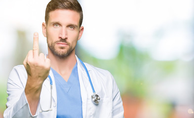 Handsome doctor man wearing medical uniform over isolated background Showing middle finger, impolite and rude fuck off expression
