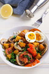 Healthy food bowl: salmon, eggs, potatoes, mushrooms, rice and spinach on white wooden table. vertical