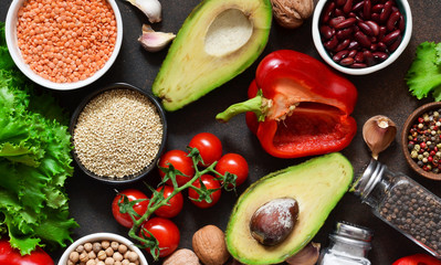 Fresh, raw vegetables on the kitchen table. Health food, clean food, choice: fruits, vegetables, seeds, superfoods, cereals, leafy vegetables. Ingredients for cooking. Top view.