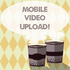 Word writing text Mobile Video Upload. Business concept for add videos on website or blog using cell phone Two To Go Cup with Beverage and Steam icon Blank Speech Bubble photo