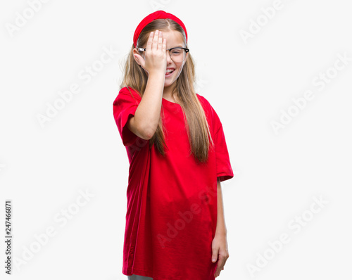 1b90c41a3369 Young beautiful girl wearing glasses over isolated background covering one  eye with hand with confident smile