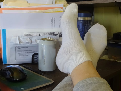 feet up soda on hand relaxed between computer chores