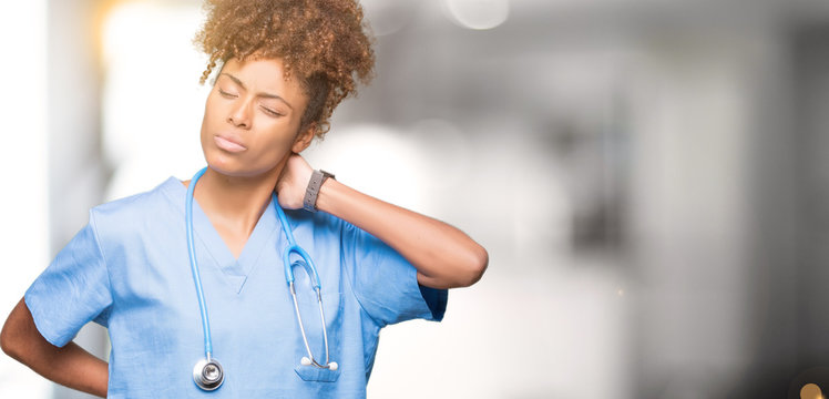 Young african american doctor woman over isolated background Suffering of neck ache injury, touching neck with hand, muscular pain