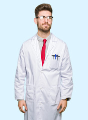 Young handsome scientist man wearing glasses smiling looking side and staring away thinking.