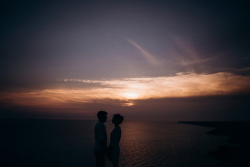 Beautiful couple on sunset photoshoot