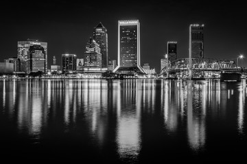 Wall Mural - The skyline reflecting in the St. John's River at night in Jacksonvile, Florida.