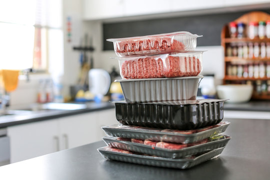 meat sitting on a kitchen bench in plastic packaging form the supermarket, grocery store