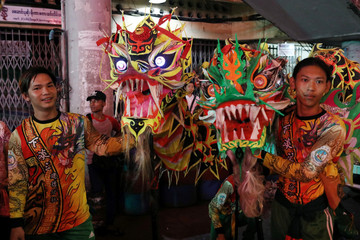 A lion dance crew takes a break ahead of Chinese New Year in Yangon