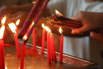 People light up incense to pray at a temple ahead of Chinese New Year in Yangon