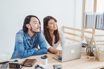 Young Asian man and woman working at home with internet laptop for online business concept