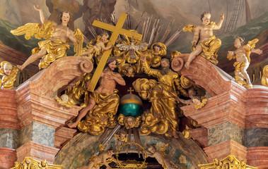 PRAGUE, CZECH REPUBLIC - OCTOBER 18, 2018: The baroque sculptural group of Holy Trinity in church Kostel Svaté Kateřiny Alexandrijské by František Ignác Weiss (1737 - 1741).