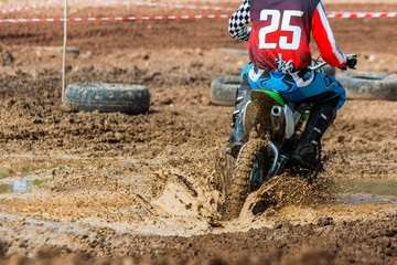 Motocross,action,Motorbike wheels spin on the mud,wheel on the mud.