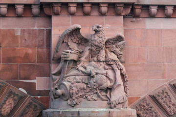 Stone eagle sculpture on Moltke Bridge Berlin Germany