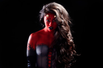 sexy asian woman with long black hair wearing fantasy red and black devil body paint costume