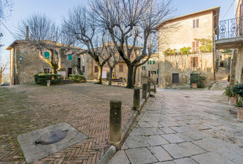 Piazza della Vittoria in the medieval village of Monticchiello without people, Siena, Tuscany, Italy, Europe