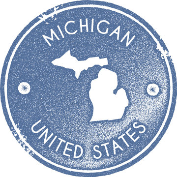 Michigan map vintage stamp. Retro style handmade label, badge or element for travel souvenirs. Light blue rubber stamp with us state map silhouette. Vector illustration.