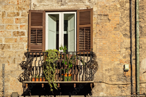 Window and balcony. Palermo, Sicily, Italy\
