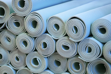 Blue Foam Yoga Mats Rolled up on Display at Gym