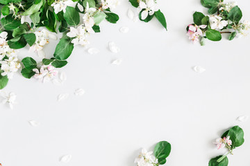 Flowers composition. Apple tree flowers on pastel gray background. Spring concept. Flat lay, top view, copy space