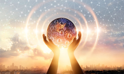 Hands holding earth and wave circle global structure network connection and data exchanges customers worldwide on sunset background. Innovation and inspiration. Networking and technology concept