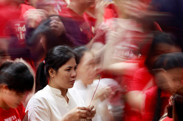 Woman lights an incense stick on Chinese Lunar New Year at a temple in Binondo, Manila