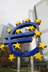 Symbol of Euro in front of Eurotower skyscraper in Frankfurt am Main, Germany